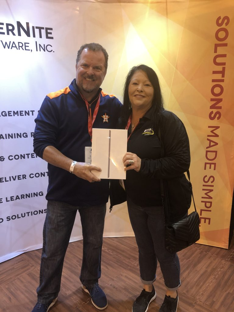 OSI Sales Manager Kevin Snedecor with the winner of an iPad prize at Clean Gulf 2019
